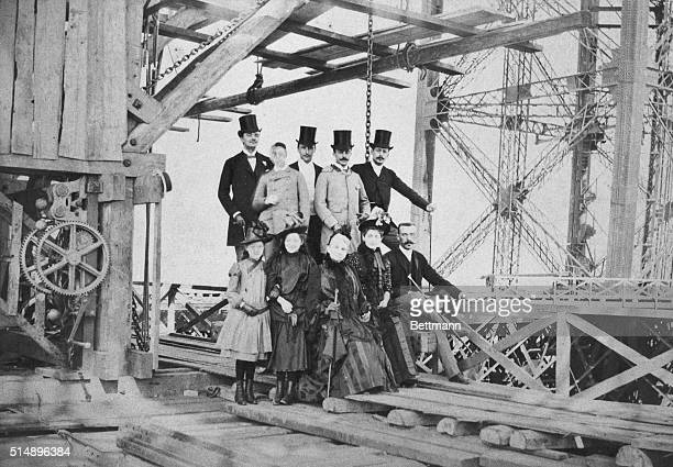 Eiffel Tower during construction. Eiffel, a family and fellow entrepreneur pose for a picture. Photo illustrates technological laws against which...