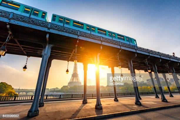 eiffel tower from bir hakem bridge at dusk, paris, france - hauptstadt stock-fotos und bilder