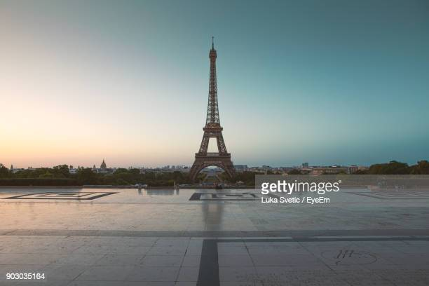 Eiffel Tower In City Against Sky During Sunset
