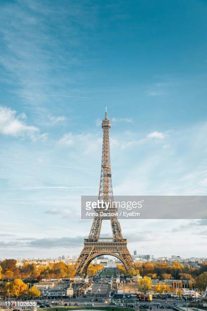 eiffel tower in city against sky - eiffel tower paris stock pictures, royalty-free photos & images