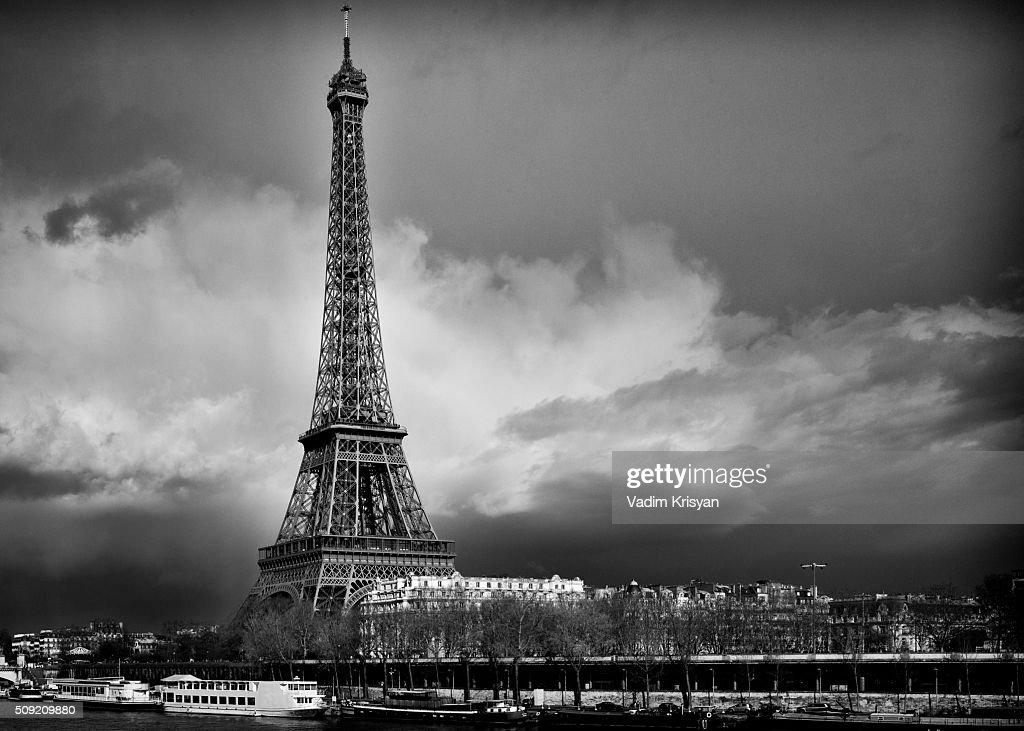 Eiffel Tower in dramatic sky, black & white : Stock Photo