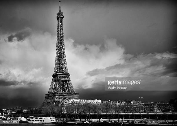 Eiffel Tower in dramatic sky, black & white