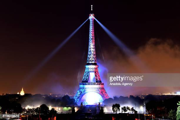 Eiffel Tower is being illuminated in the colors of the French flag as part of the Bastille Day celebrations in Paris France on July 14 2017