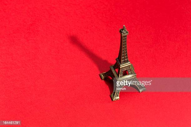 Eiffel Tower on red background