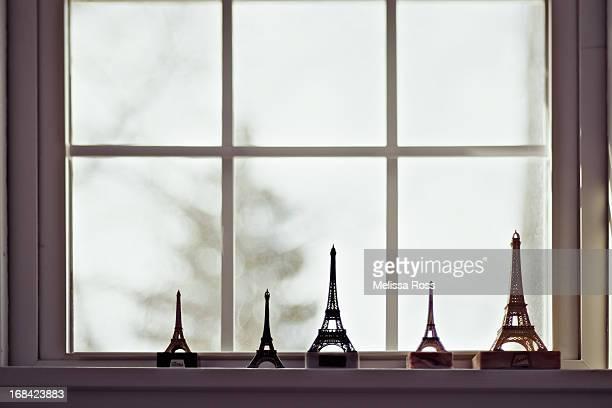 Eiffel Tower replicas displayed on a windowsill