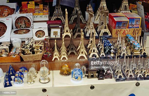 Eiffel tower souvenirs in a shop window.