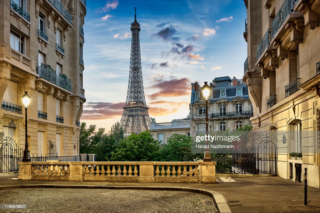 Eiffel Tower with Haussmann apartment Buildings in foreground, Paris, France : Photo