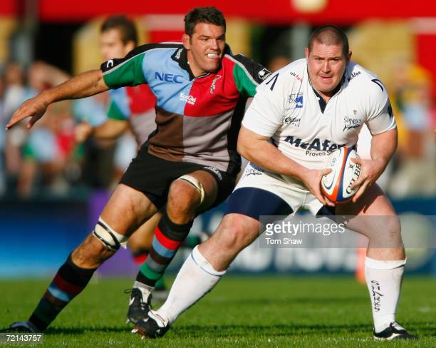 Eifion Roberts of Sale is tackled by Nicholas Spanghero of Harlequins during the EDF Energy Cup between NEC Harlequins and Sale Sharks at the Stoop...