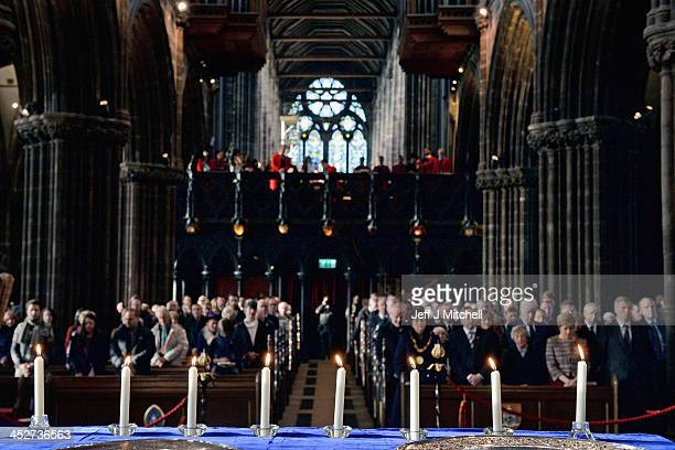 Eight candles are lit during a service at Glasgow Cathedral in memory of the eight people who lost their lives when a police helicopter crashed into...