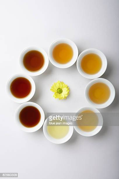 eight cups of different variations of traditional chinese tea. - medium group of objects stock pictures, royalty-free photos & images