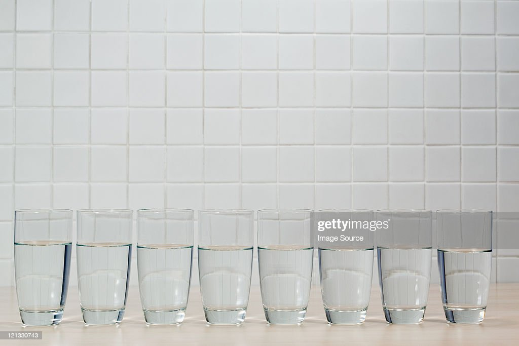 Eight glasses of mineral water : Stock Photo