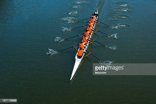 eight man rowing team - teamwork - sportteam stockfoto's en -beelden