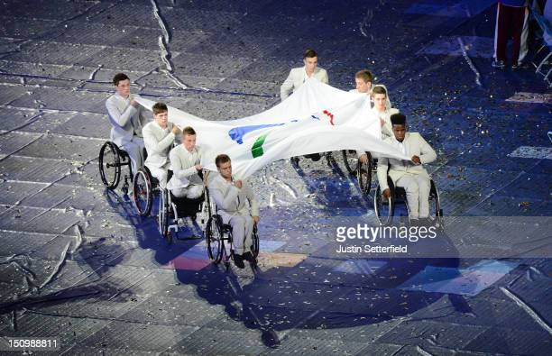 Eight members of the Great Britain U22 Wheelchair Basketball team carry the Paralympic flag during the Opening Ceremony of the London 2012...