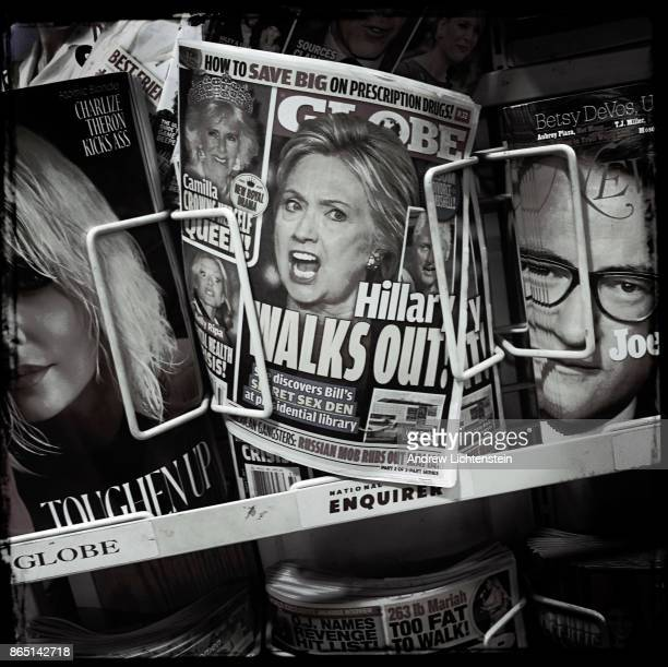 Eight months after the 2016 presidential election tabloids still advertise headlines about Hilary Clinton at supermarket check out line on August 1...