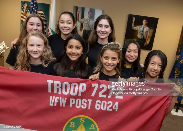 Eight of the 22 founding members of the county's first allgirl Boy Scout Troop pose for photo after submitting their application during a ceremony at...