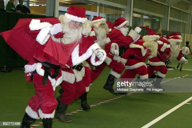 Eight Santas in the quickest present sack hauling race take part in the inaugural Guinness World Records 'Santathon' for title of the Ultimate Santa...