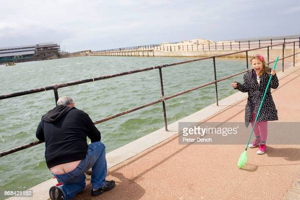 Eight year old Georgina Jackson hooks for crabs in Marine Lake with her Grandad Kenneth In 1986 world famous photographer Martin Parr published his...