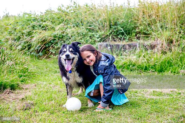 eight year old girl with border collie - hairy little girls stock photos and pictures