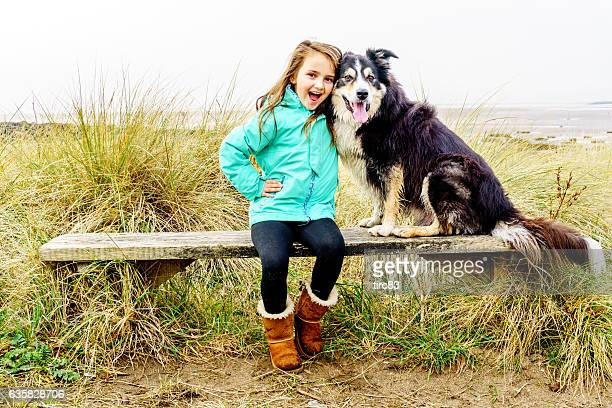 Eight year old girl with dog in winter countryside setting
