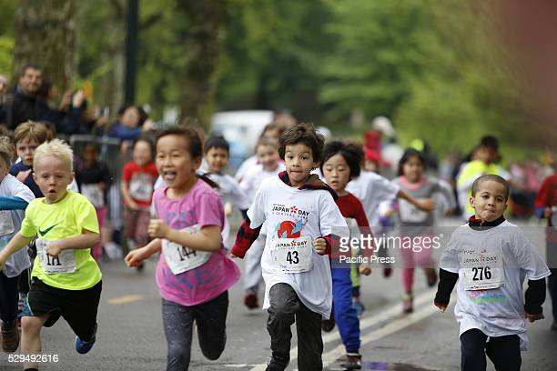 Eight year old kids approach finish line Early am rain abated in time for the tenth annual Japan Day in Central Park that included a Kids' Run...