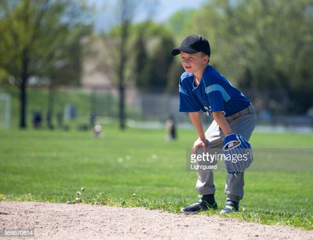 eight year old little league boy - little league stock pictures, royalty-free photos & images