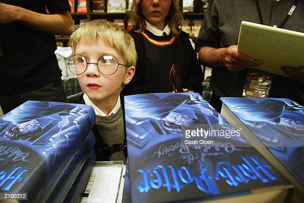 Eight year old Mason Hoppe waits for his chance to purchase a copy of the new 'Harry Potter and the Order of the Phoenix' book by JK Rowling at...