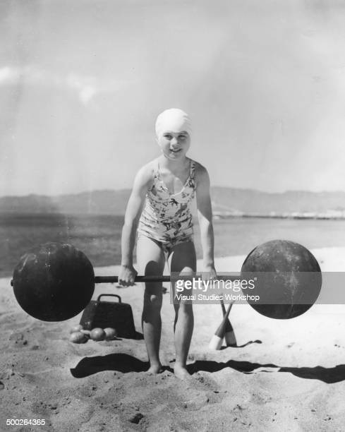 Eight year old Patricia O'Keefe weighing 64 pounds lifting heavy weights that adults could not even budge Venice California early to mid 20th century