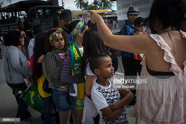 Eight year old Tiago Porfirio Afonso from the Cantagalo 'favela' community waits first in line to be handed his Olympic ticket outside the Olympic...
