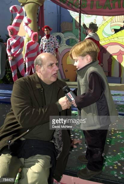 Eight yearold actor Josh Ryan Evans right conducts a television interview with fellow actor Jeffery Tambor following a promotional event for...