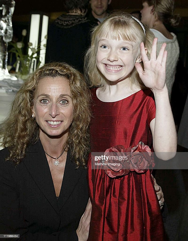 Eight year-old Dakota Fanning who is currently filming Dr. Seuss's Cat In the Hat has a major role in Steven Spielbergs Taken. The 20 hour mini-series premieres December 2, 2002 on the SCI FI Channel. Here Dakota poses for photographers with SCI FI President Bonnie Hammer.