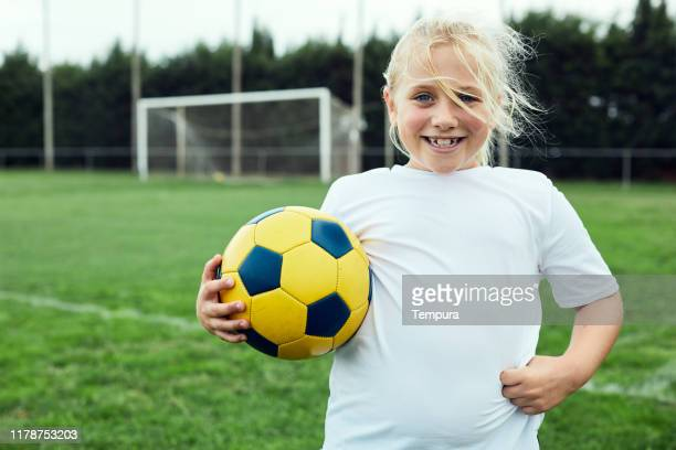 eight years old soccer player portrait looking at camera. - 8 9 years stock pictures, royalty-free photos & images