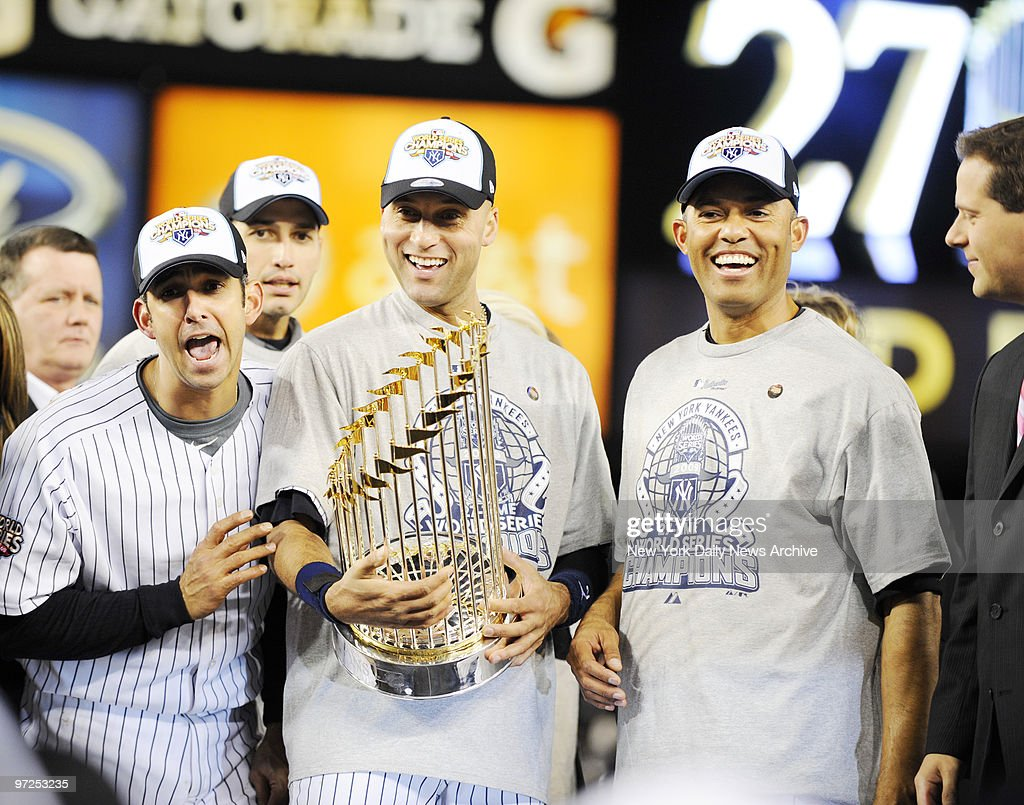 Eight years to the day his blown save ended Yanks' dynasty, Mariano Rivera (r.) celebrates another title, as do (from l.) Jorge Posada, Andy Pettitte and Derek Jeter.