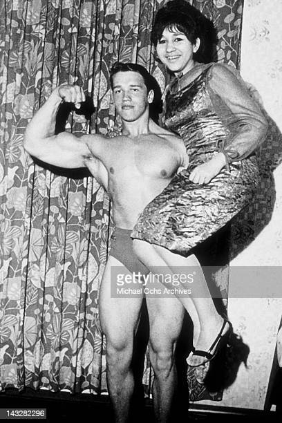 eighteen year old bodybuilder Arnold Schwarzenegger lifts a friend in 1965 in Thal Austria