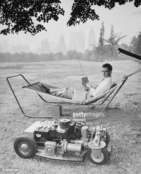 Eighteen year old inventor David W Howell relaxes in the shade of Central Park while he demonstrates Mighty Mow a remote controlled lawn mower The...