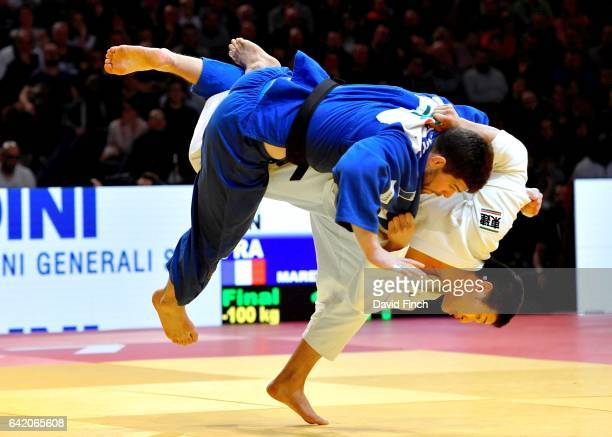 Eighteen year old Kentaro Iida of Japan throws Olympic bronze medallist Cyrille Maret of France for a wazari to win the u100kg final and the gold...