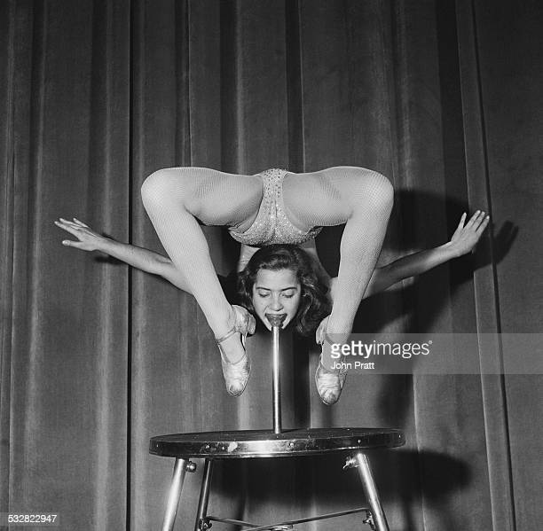 Eighteen yearold Austrian acrobat Eleonore Gunter bending over double as she supports her weight from her mouth by biting on a speciallydesigned...