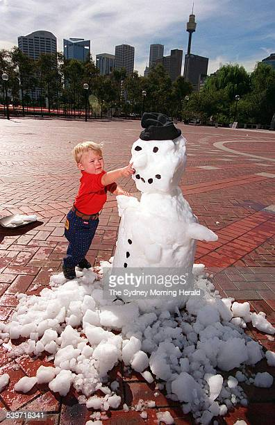 Eighteenmonthold Patrick Killen of Cooma plays with a snowman melting on an unseasonally hot Sydney day with tremperatures nearing 26 degrees celcius...
