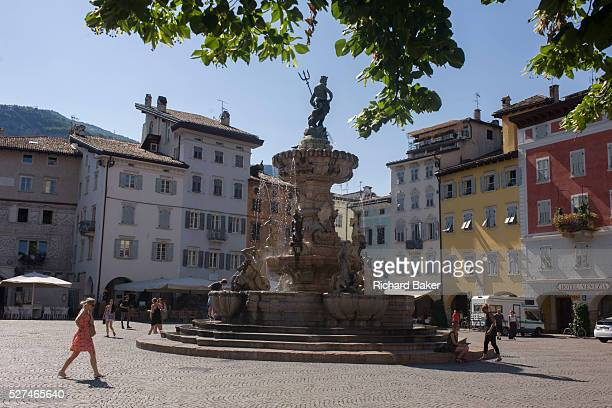 Eighteenth century Neptune fountain in Piazza Duomo Trento We see a wide view of the Piazza with the late Baroque Fountain of Neptune built in...