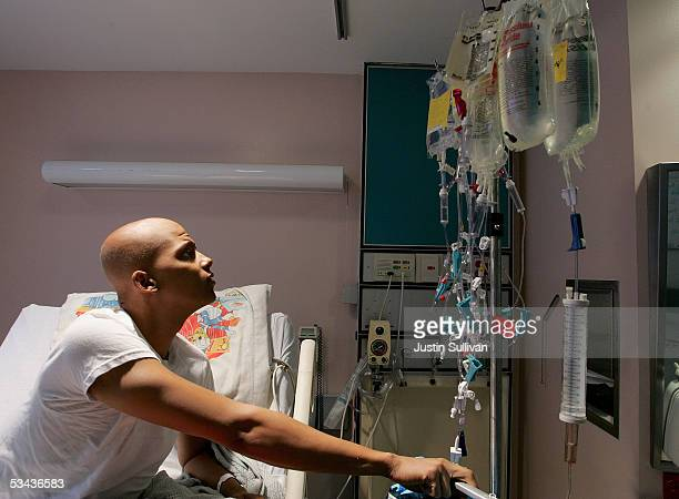 Eighteenyearold cancer patient Patrick McGill looks at a rack holding bags of chemotherapy while receiving treatment for a rare form of cancer at the...