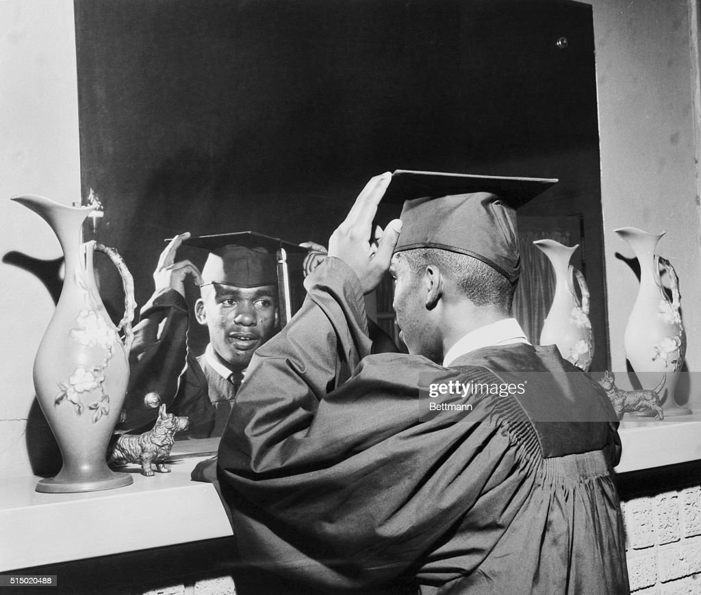 Eighteen-year-old Ernest Green, one of the nine African American students to integrated Central High School, prepares for graduation.