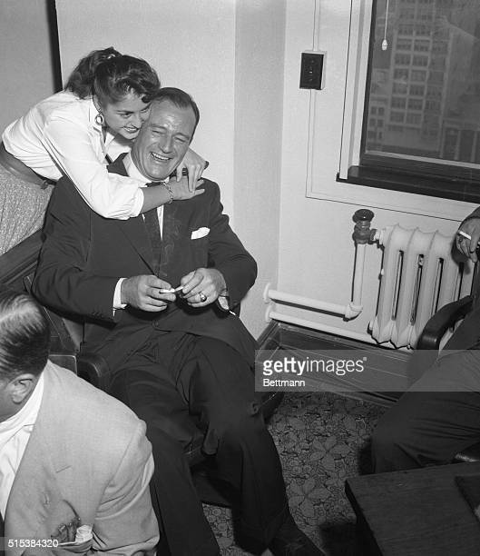 Eighteenyearold Kathlyn Koulous one of the secretaries in the Los Angeles court trial of the divorce suit against John Wayne filed by his wife...