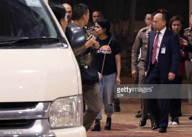 Eighteenyearold Saudi woman Rahaf Mohammed alQanun is escorted to a vehicle by a Thai immigration officer and United Nations High Commissioner for...