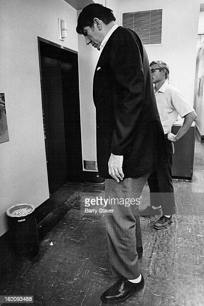 CHRISTIANITY Eightfoot tall Max Palmer waits for an elevator in The Post building after an interview Friday Palmer one of the tallest men in the...