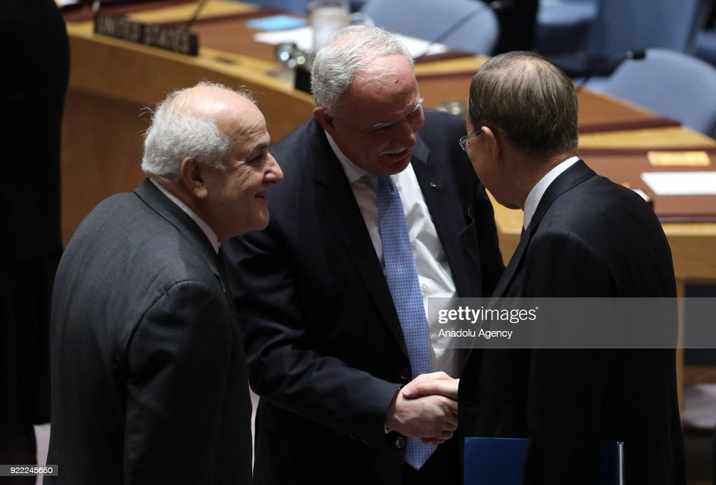 Eighth Secretary-General of the United Nations Ban Ki-mun (R) shakes hands with Palestinian Foreign Minister Riyad al-Maliki (C) during the United Nations Security Council meeting in New York, United States on February 21, 2018.