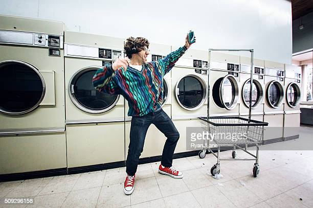 eighties man dancing at laundromat - 1980 bildbanksfoton och bilder