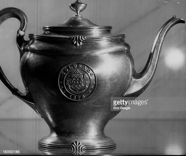 3171959 MAR 18 1959 Eightinch sterling silver teapot with bone inlay on handle bears seal of State of Colorado and honors state's date of entry into...