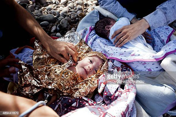 Eightmonth old twins from Syria lie on Eftalou beach west of the port of Mytilene on the Greek island of Lesbos after their parents crossed the...