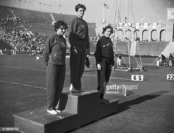 Eighty meter hurdles' winner's podium Left to right Evelyn Hall of US second Babe Didrikson of US first Marjorie Clark of South Africa third