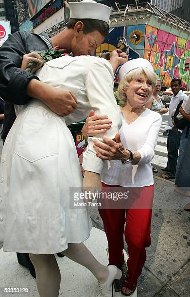 Eighty six-year-old Edith Shain stands in Times Square beside a statue of her famous kiss with a sailor on V-J Day at the end of World War II August...
