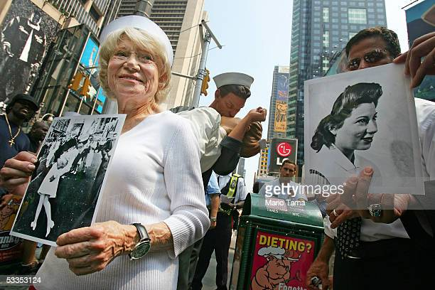 Eighty sixyearold Edith Shain stands in Times Square to welcome a statue of her famous kiss with a sailor on VJ Day at the end of World War II August...
